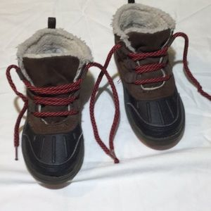 Oshkosh hiking boots water resistant lower area.